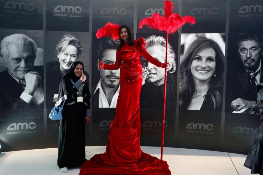 A woman poses at a cinema in Riyadh