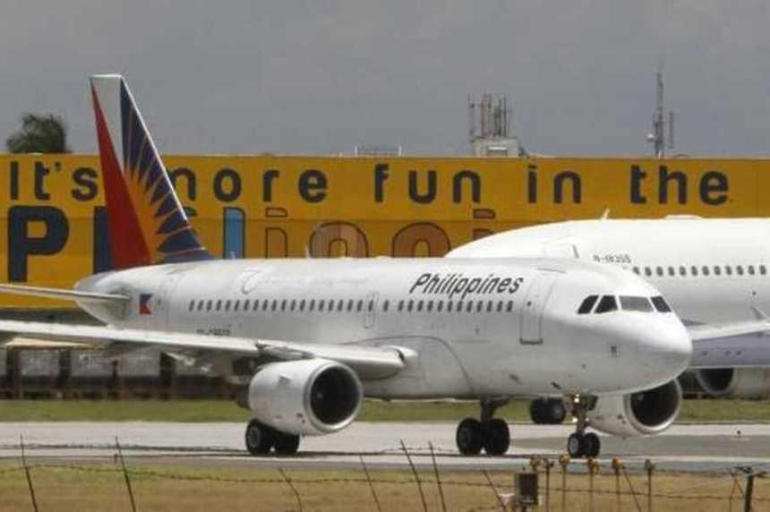 A Philippine Airlines (PAL) plane, the country's flag carrier, waits at the tarmac of the international airport in Manila