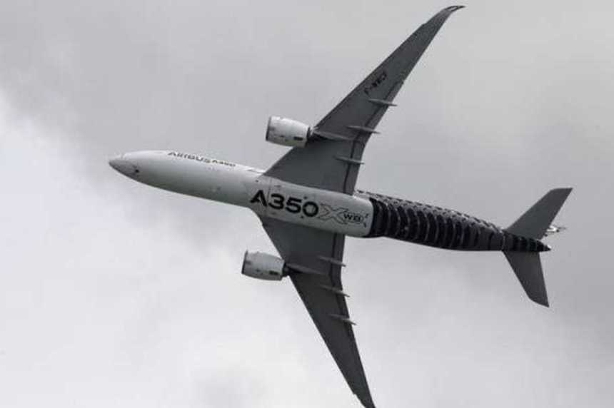 An Airbus A350 flies past during a preview aerial display of the Singapore Airshow at Changi exhibition center in Singapore